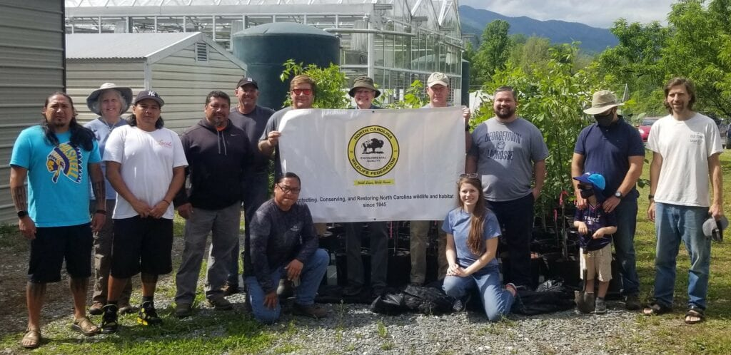 NCWF and Eastern Band of Cherokee Indians pose at planting event.