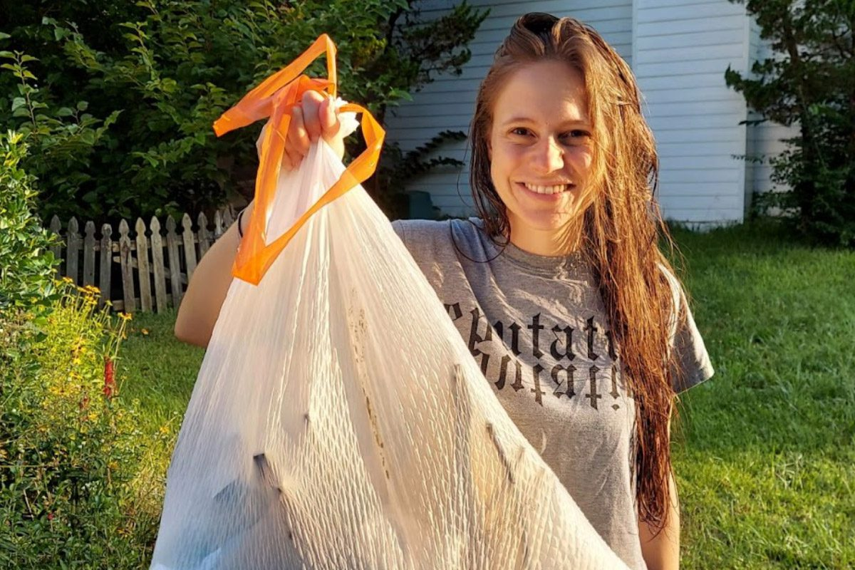 Community Activist holding up a bag of collected trash